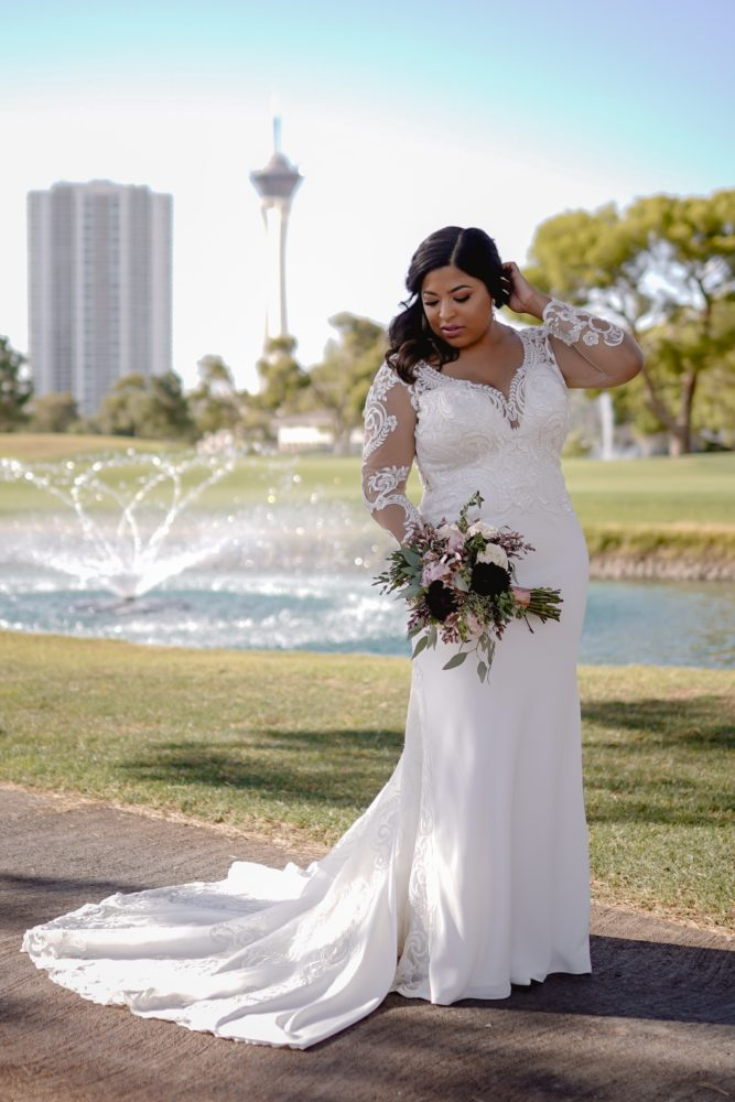 Adrienne's Jaw-Dropping Plus Size Sheath Wedding Gown with Illusion Long Sleeves.
