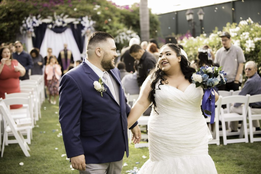 newlyweds after ceremony plus size mermaid wedding dress