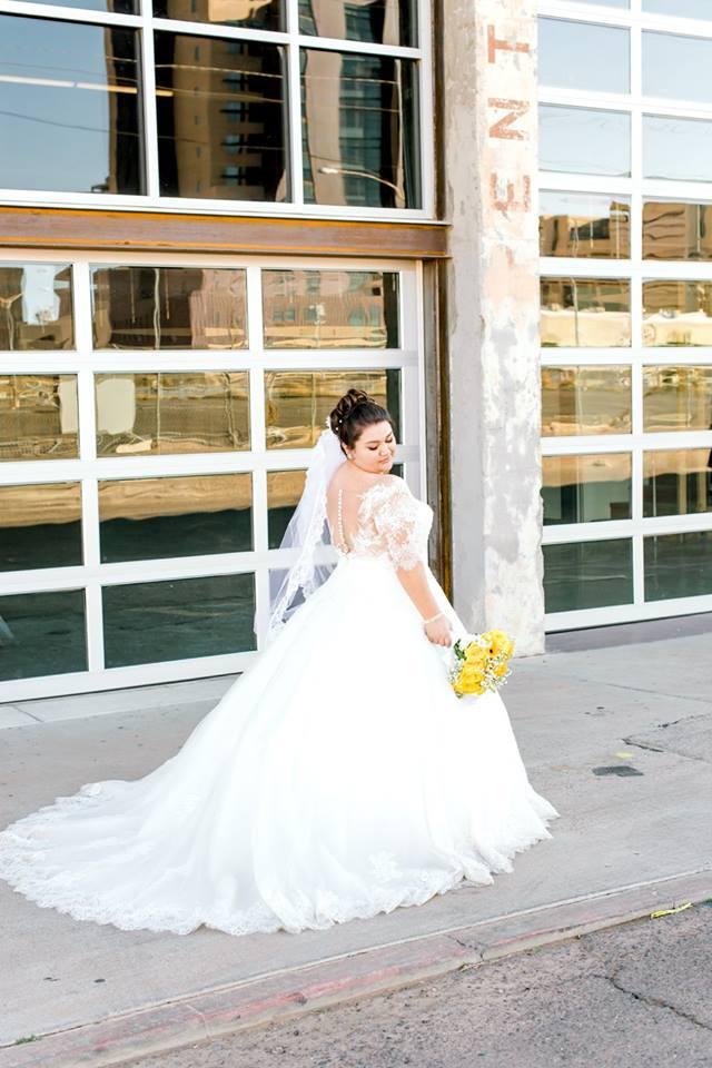 curvy bride in illusion back plus size ballgown wedding dress