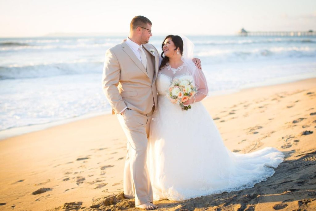 beautiful plus size bride on the beach