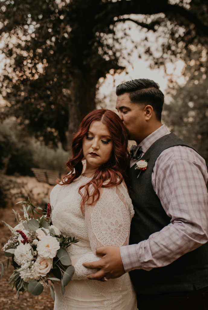 plus size bride in fitted wedding gown with lace sleeves