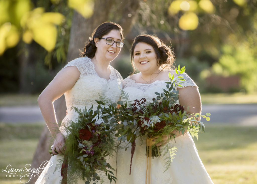 plus size bride with off the shoulder wedding dress