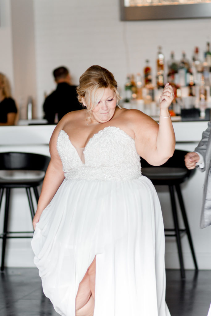 curvy bride in sexy slit wedding dress