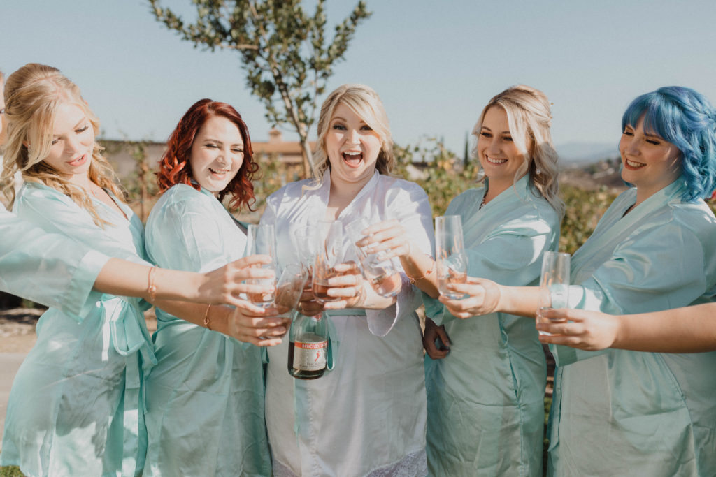 bride and bridesmaid in robes