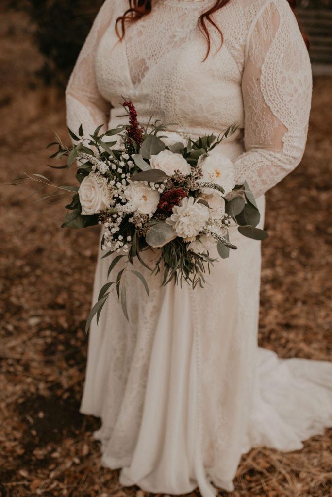 Long sleeve plus size boho wedding dress with lace and chiffon panels.