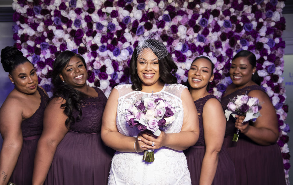 plus size bride and bridesmaids wearing purple
