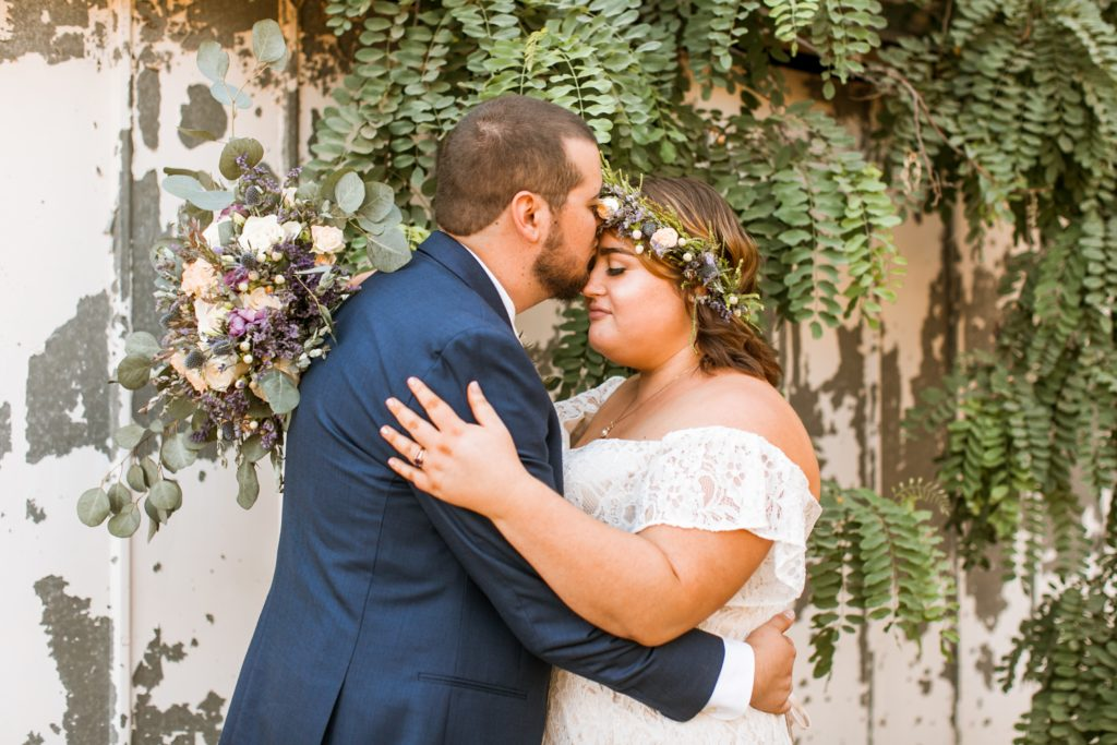 plus size bride wearing off the shoulder lace wedding dress