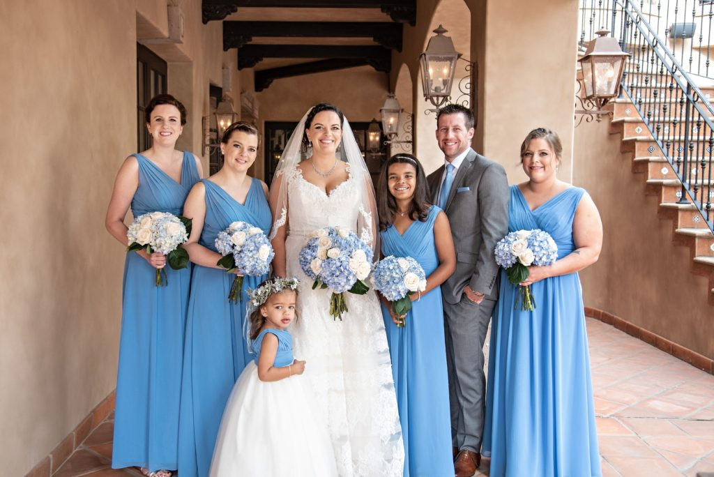 curvy bride with bridesmaids in blue gowns