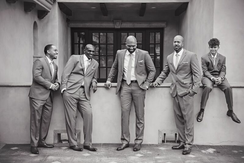 black and white picture of groomsmen chuckling