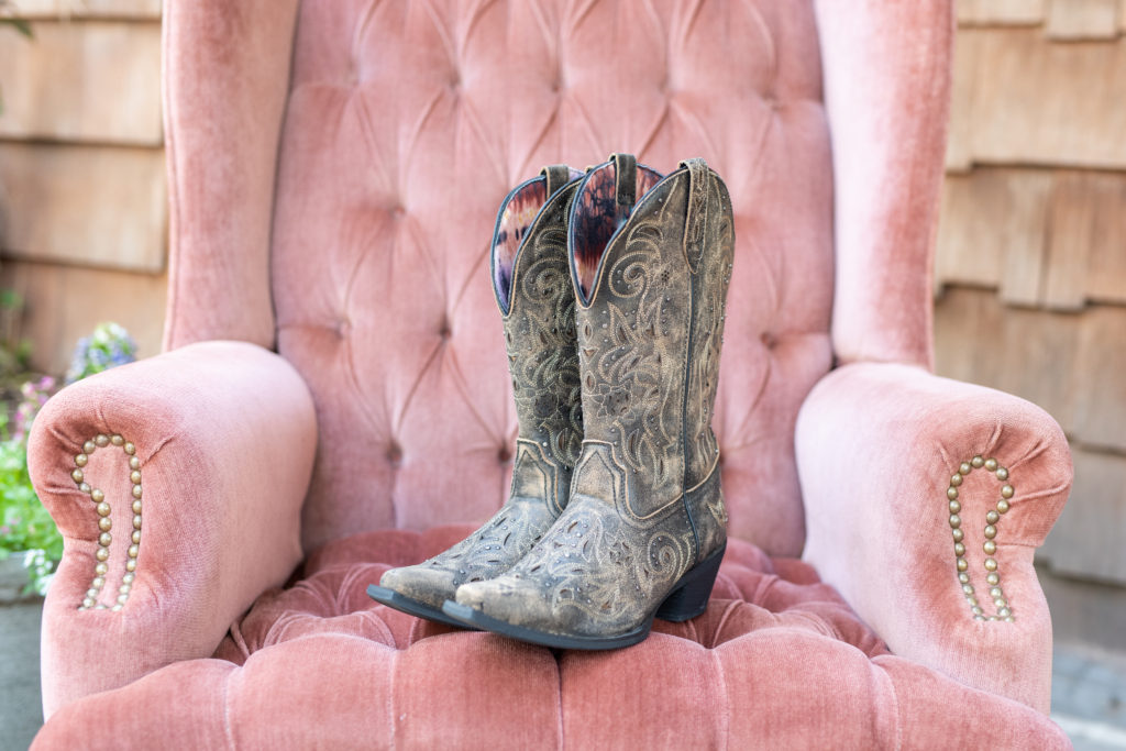 cowboy boots on a pink chair