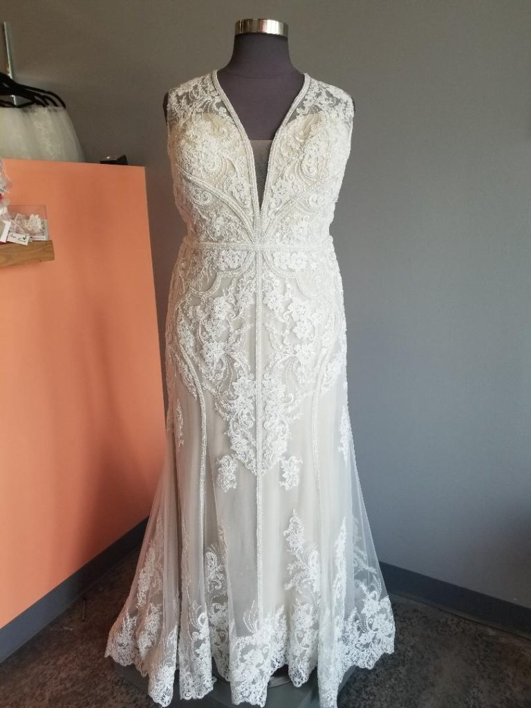 Slim sheath with wide straps and beaded and lace design on a plus size wedding dress