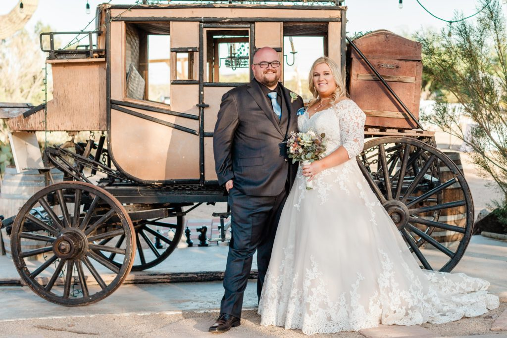 couple in front of stagecoach