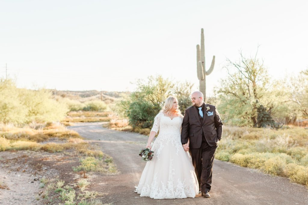 bride and groom walking in Arizona desert