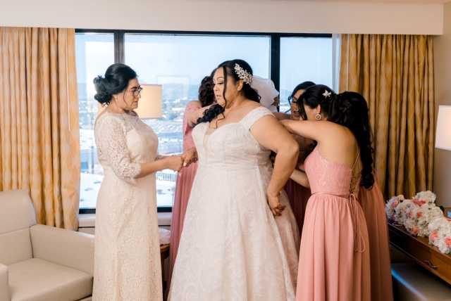 plus size bride with bridesmaids and mother