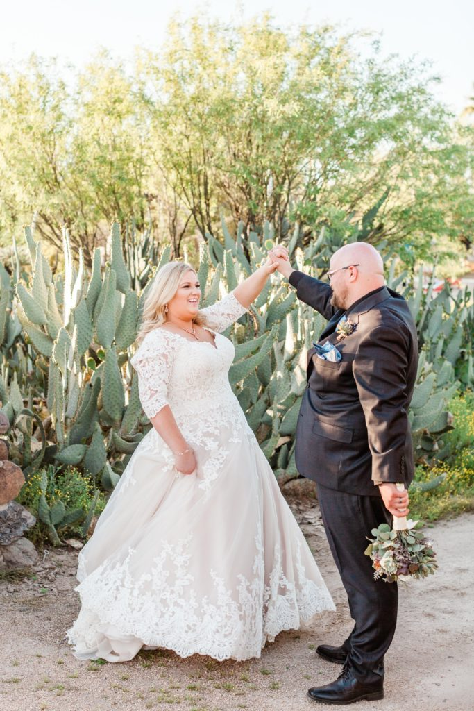 bride twirling in plus size wedding dress in Arizona