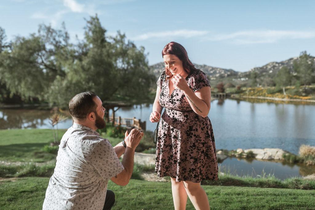 surprise engagement man kneeling