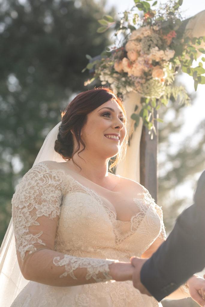 bride wearing long sleeve lace wedding dress
