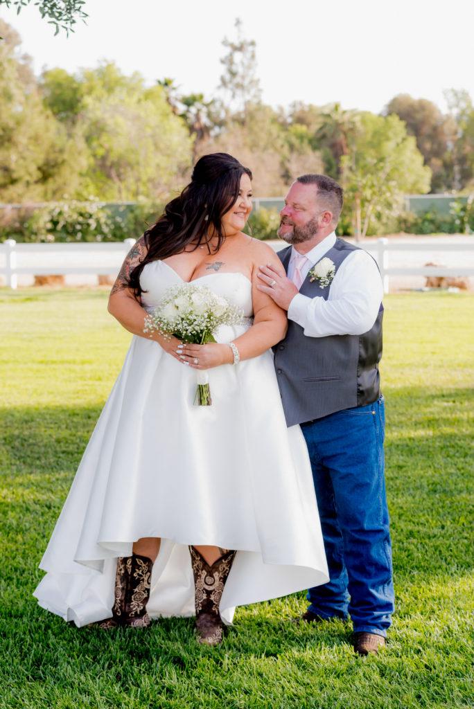 wedding-couple-hi-low-hem-wedding-dress-jeans-andvest