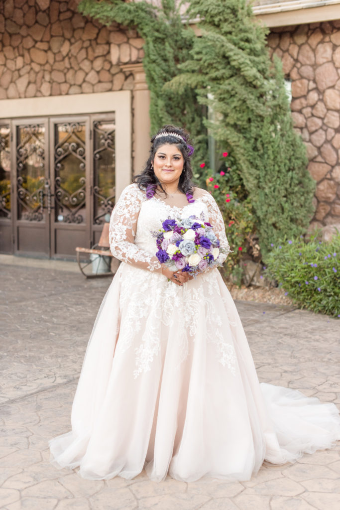 bride wearing long sleeve lace ballgown wedding dress