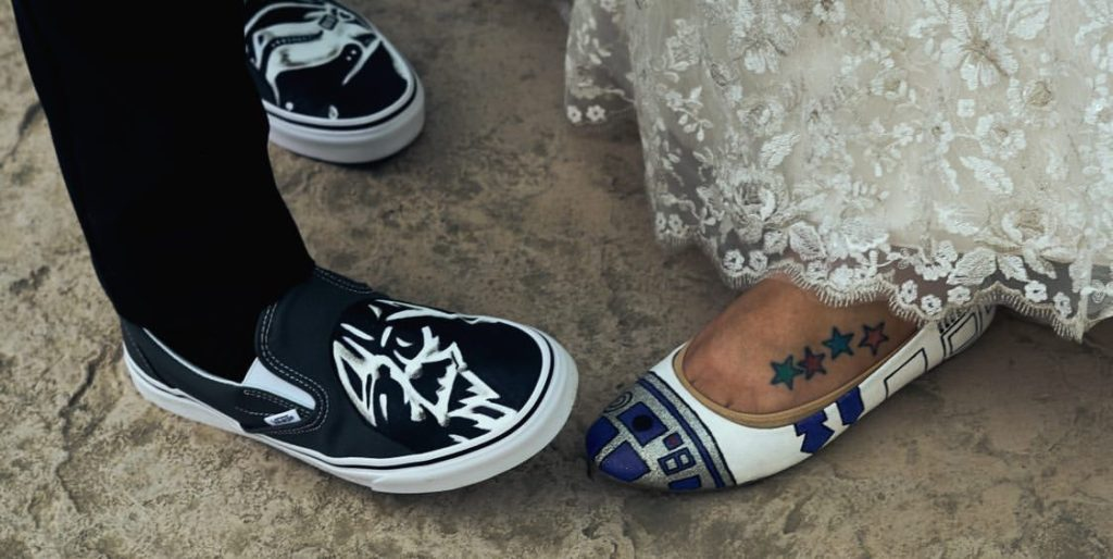 bride and groom wearing custom star wars themed shoes