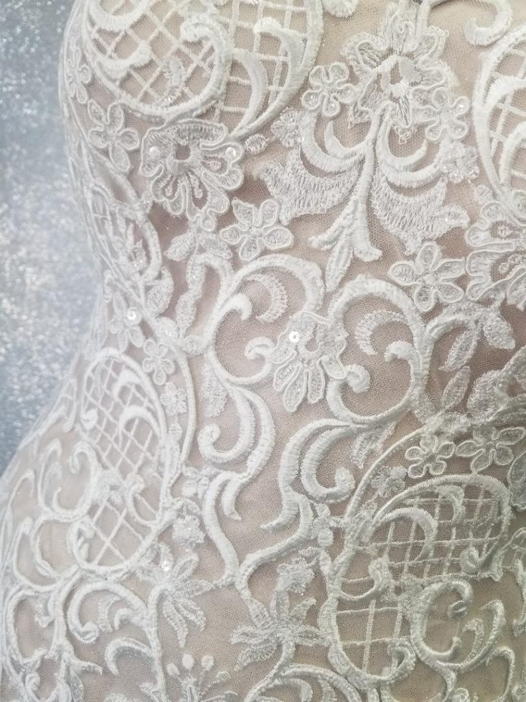 textured-lace-bodice-of-plus-size-wedding-dress