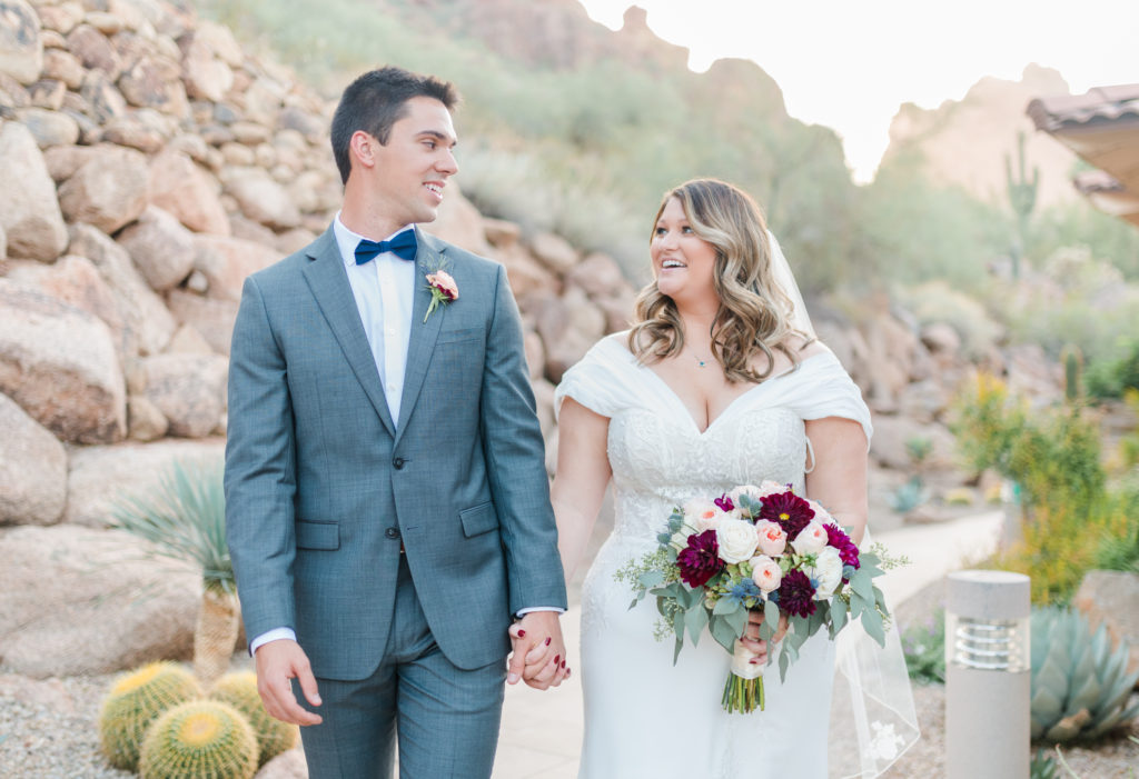 bride-and-groom-walking-around-camelback-inn-arizona