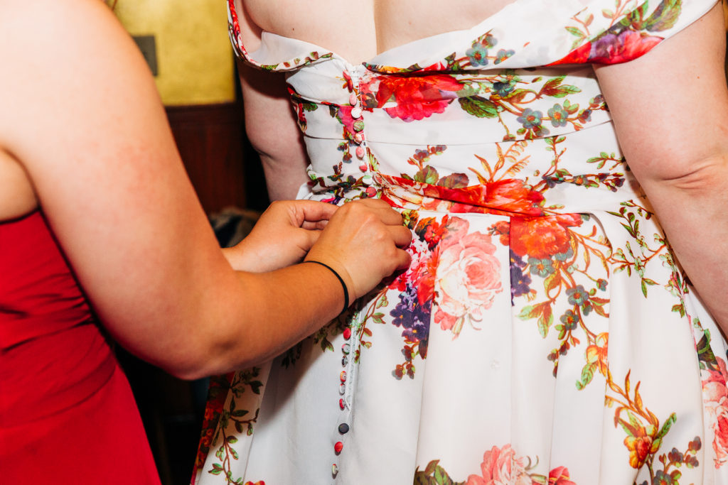 close-up-of-buttons-floral-wedding-dress-california