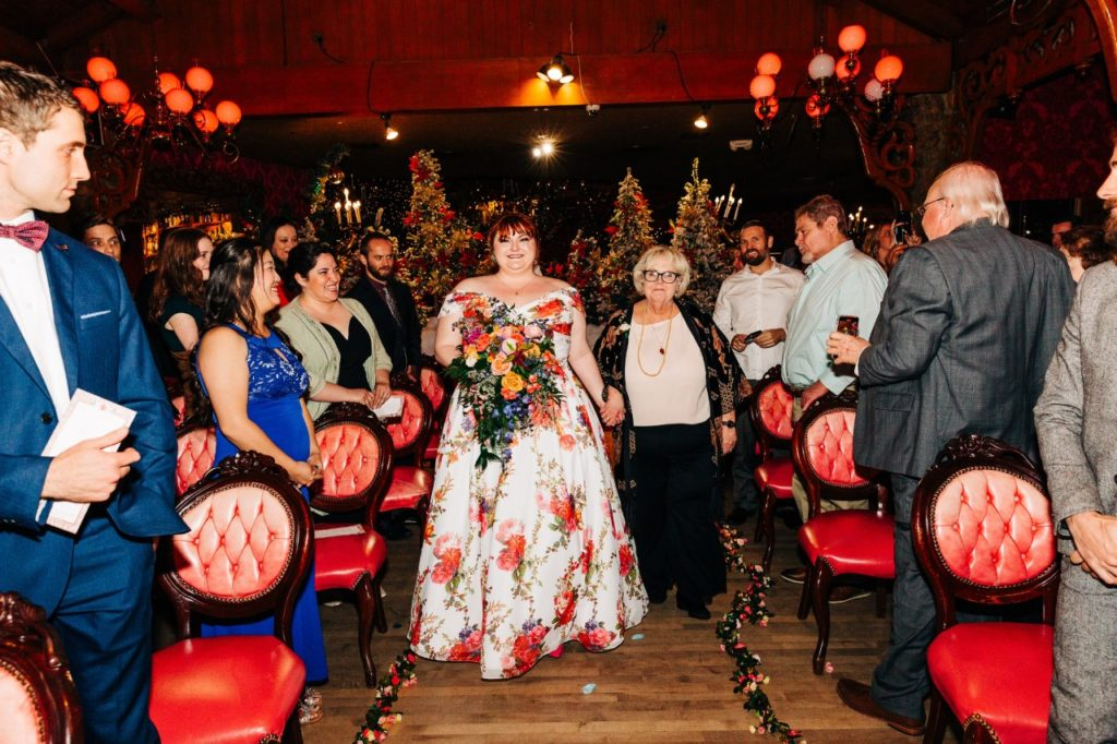 plus-size-bride-walking-down-the-aisle-in-unique-wedding-dress