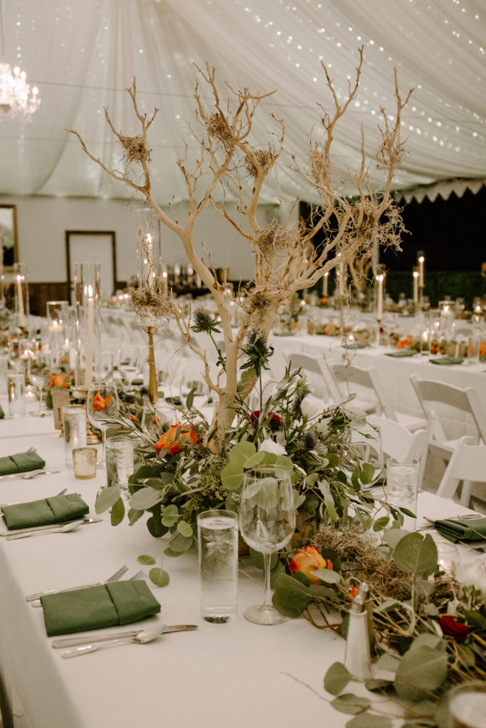 rustic tent wedding with branch centerpieces